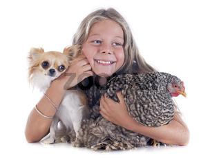 child, dog and chicken