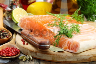 Fresh salmon fillet with herbs and spices.