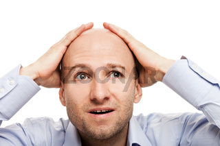Amazed or surprised bald-headed man