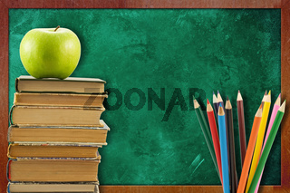 books with apple and pencils