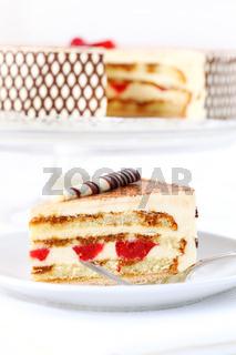 Delicious Tiramisu birthday cake with cherries