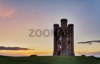 Broadway Tower at sunset with colorful sky, Cotswolds, UK