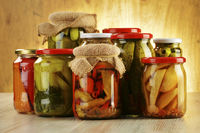 Composition with jars of pickled vegetables