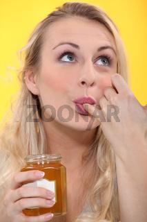 woman tasting jam