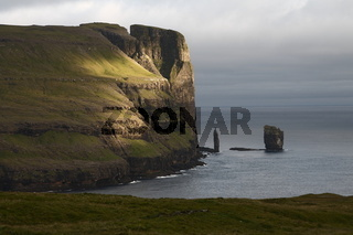Risin and Kellingin - sea stacks at the coast near Eiði on the Eysturoy island