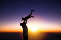 The silhouette of happy father and little girl wit