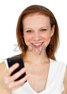 Attractive businesswoman sending a text