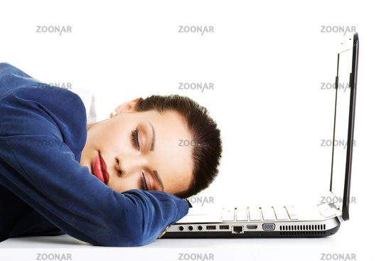 An exhausted businesswoman is sleeping
