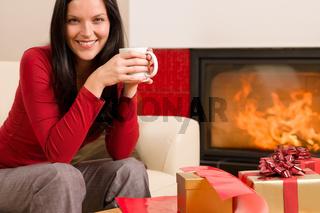 Christmas present wrap woman drink home fireplace