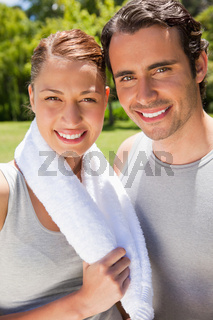 Woman holding a towel smiling with a man