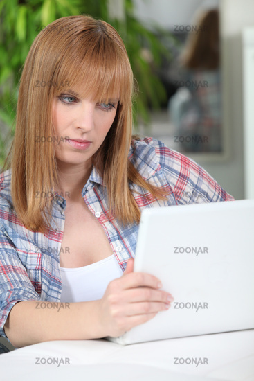 Redheaded woman using a laptop