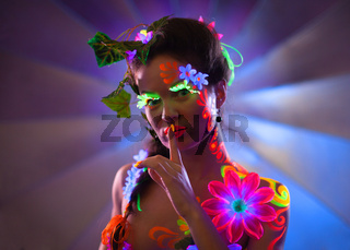 Portrait of glowing woman with uv make-up