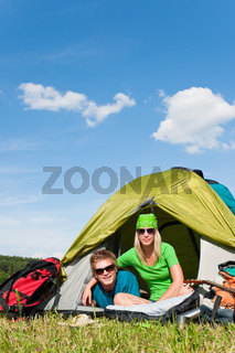 Camping couple lying inside tent summer countryside