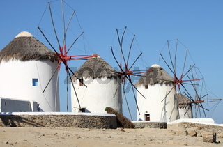 Windmills on a hillside near the sea in Mykonos Island