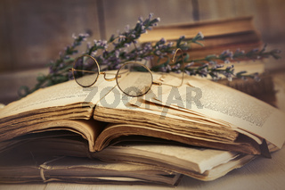Old books open on wooden table