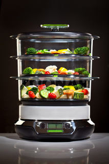 Healthy cooking, steam cooker with vegetables