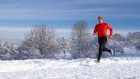 Jogger in snowy landscape
