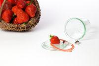 Basket with strawberries and mason jar