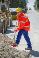 Construction worker with shovel in hand
