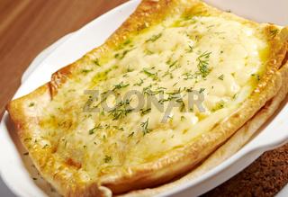Qutab -baked  lavash cheese pie