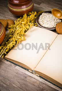 Oatmeal cookies and an old recipe book on the kitchen table