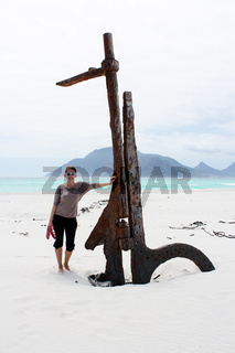 Woman standing at Shipwreck Kakapo at the beach of kommetjie