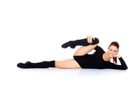 Cute brunette woman doing stretching