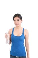 woman in fitness attire holding water bottle
