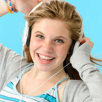 Carefree teenage girl dancing to music