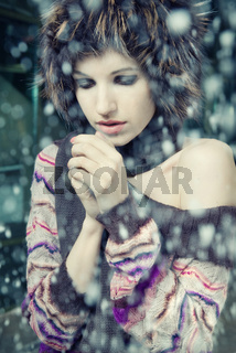 young woman freeze under falling snow