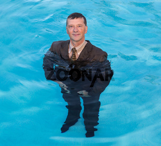 Senior business man in deep water