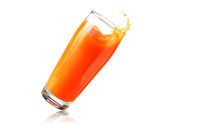 Big glass of orange juice falling over