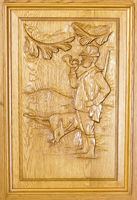 hand carved hunting scene