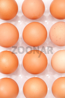 fresh yellow chicken eggs in container