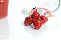 Mason jar, strawberries and jelly