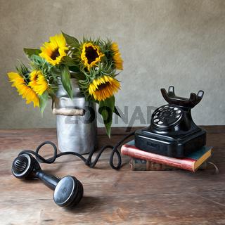 Telefon und Sonnenblumen