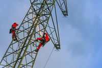 2 men working on a Pylon