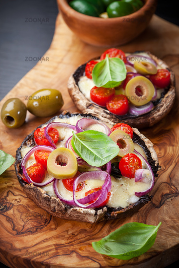 Giant Portobello mushrooms stuffed with mozzarella and tomatoes
