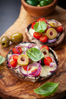 Giant Portobello mushrooms stuffed with mozzarella and tomatoes