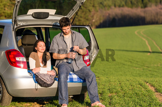Camping couple inside car summer sunset countryside