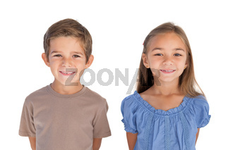 Two children standing and smiling at camera