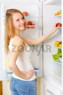 girl near the refrigerator