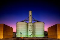 Grain storage silo in purple pink sunset dusk sky