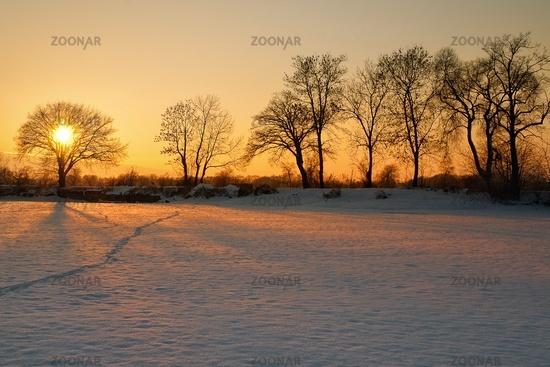 Beautiful winter sunset on the frozen lake