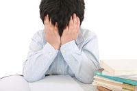 Schoolboy being stressed by his homework