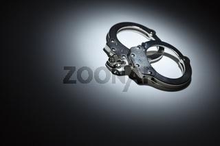 Abstract Pair of Handcuffs Under Spot Light - Text Room