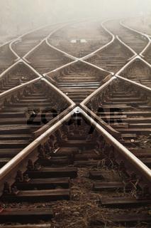 Railway in fog on station