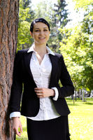 Business woman in park