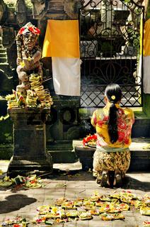 woman praying in temple bali indonesia