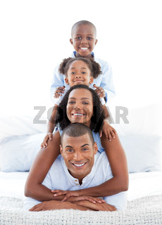 Animated family having fun lying down on bed